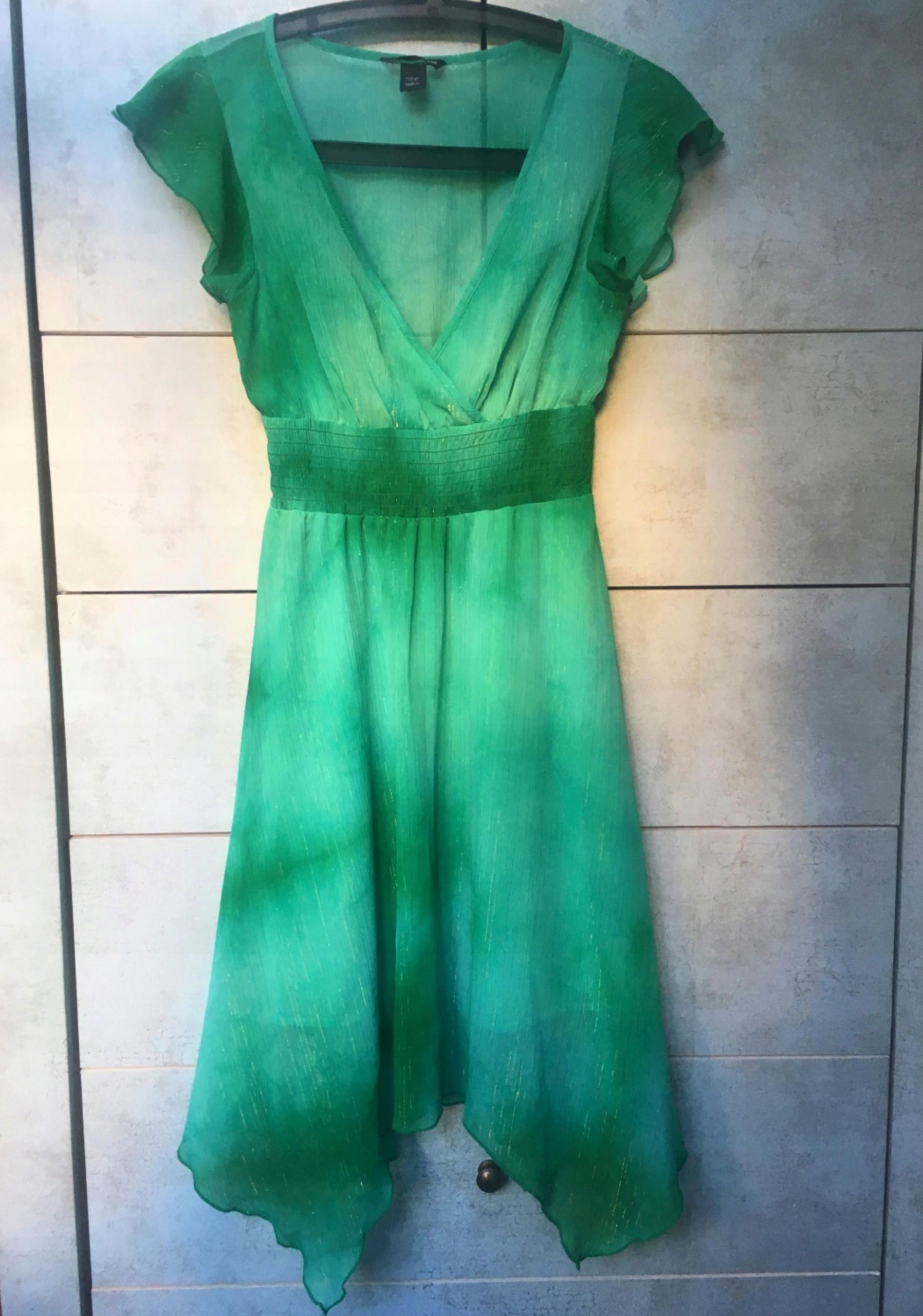 3c27f31b55 kopertowa sukienka zielona HM dekolt zakładany 36 - 7506706052 ...