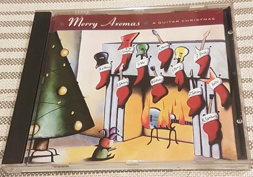 MERRY AXEMAS CHRISTMAS NA GITARĘ SATRIANI SAMBORA