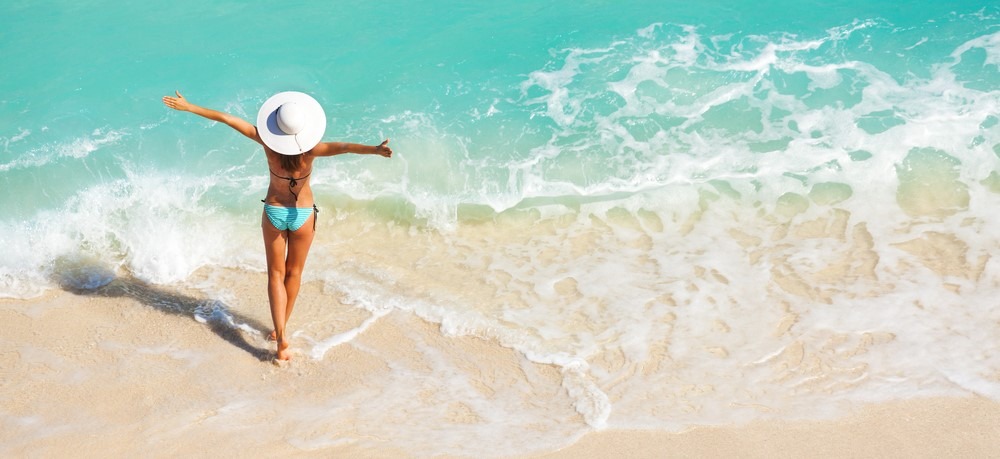 woman in the hat on the beach