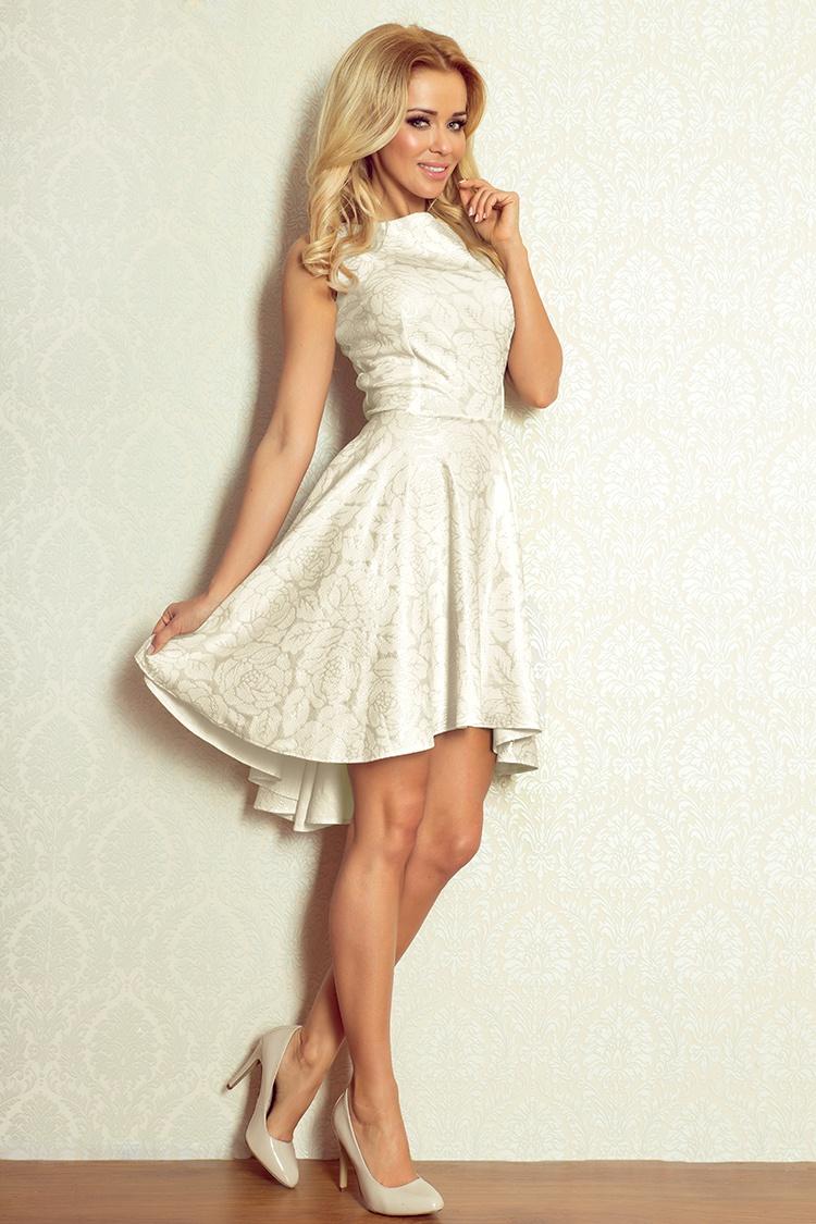 3cc9acc0d0 Ekskluzywna sukienka uszyta z wysokiej jakości materiału z połyskiem. Sukienka  pięknie podkreśla kobiece kształty.